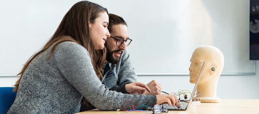 Image of PhD students Lorena Qendro (left) and Andrea Ferlini working with a Nokia Bell Labs' earable prototype as part of a collaboration with Nokia Bell Labs.