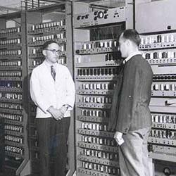 Image shows Prof Maurice Wilkes with EDSAC