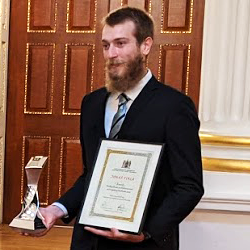 Student Jonas Fiala receives his award at the Mansion House